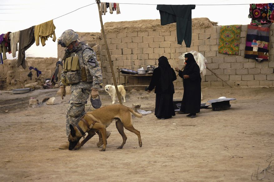 Photo by: Staff Sgt. Stacy L. Pearsall The U.S. military is trying harder to reunite soldiers with their four-legged battlefield companions, both as a way to readjust service personnel to home life and to get the dogs out of harm's way. (Associated Press - via Washington Times)