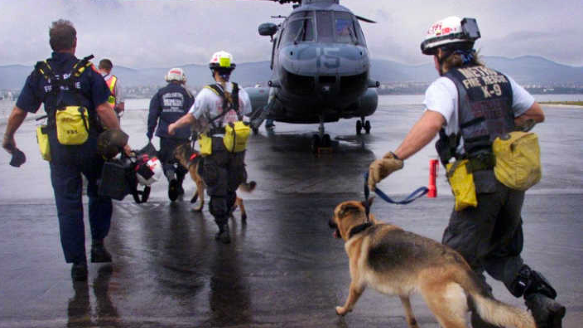 A team from Miami-Dade's Urban Search and Rescue Task Force runs to board a U.S. Marine helicopter in response to a devastating earthquake in Turkey in 1999. Photo from Miami Herald Archives