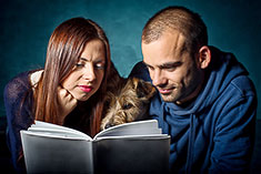 Man and Woman reading a dog breed book